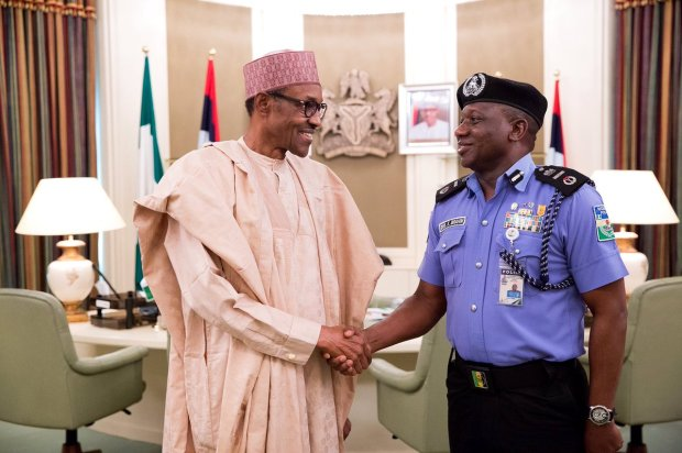 President Muhammadu Buhari congratulating the new AIG of Police, Ibrahim Idris